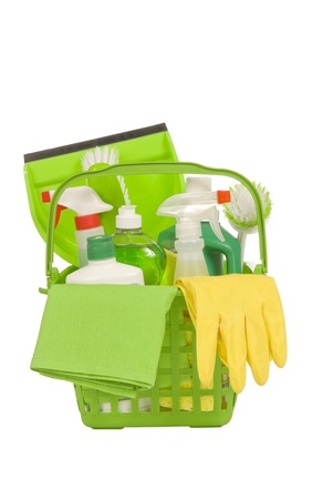 Basket of environmentally safe green cleaning supplies with yellow rubber gloves  Vertical shot   Isolated on white   Studio shot