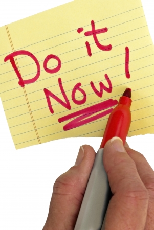 t off: Hand writing Do It Now with a red marker   Don t procrastinate   It s important to get your jobs done and not put it off   Studio shot  Stock Photo