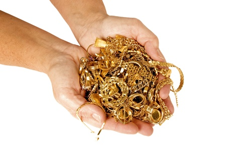 scrap heap: A big handful of gold jewelry ready to sell for cash.  Isolated on white. Studio shot. Stock Photo