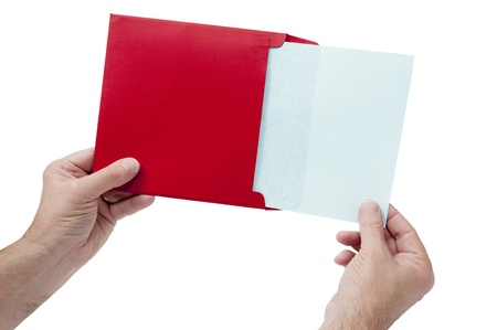 envelope: Great shot of a man holding a red envelope with a blank sheet coming out of it.  Perfect shot to use for a Valentine idea or concept. Isolated on white. Stock Photo