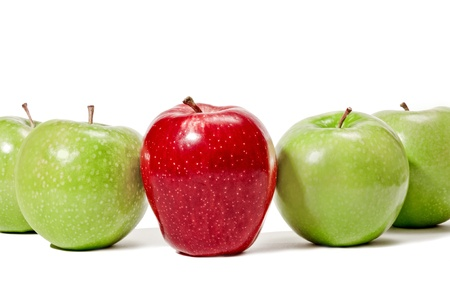 eat out: Concept of being different or standing out   Big bright red apple standing in the middle of a row of green apples   A concept for standing out in a group