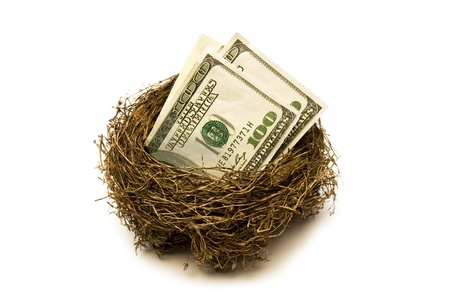 Folded hundred dollar bills put away for retirement   Everyone needs a little nest egg