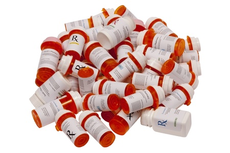 A pile of prescription bottles in all shapes and sizes.  Isolated on white.