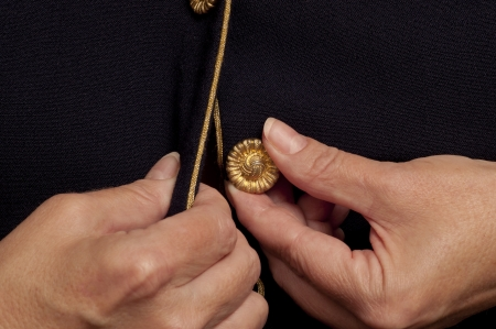 buttoning: An older woman's hands trying to button a top  Stock Photo