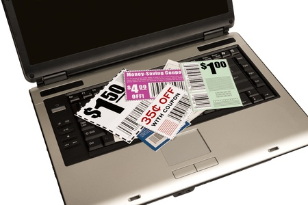xxxl: A laptop with coupons on top represents online coupons  XXXL