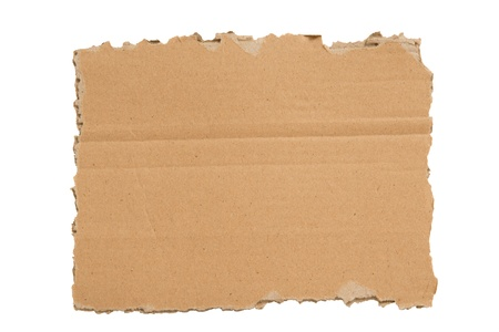 xxxl: A ripped blank piece of cardboard with rough edges   XXXL  Islated Stock Photo