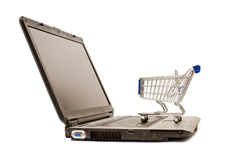 A Shopping Cart Sits on a Laptop For Online Shopping. XXXL Stock Photo - 17354730