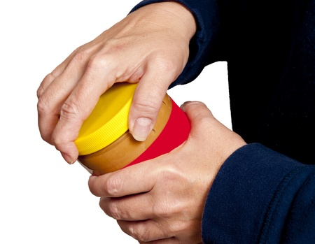 dexterity: A Horizontal picture of a woman trying to open a jar.
