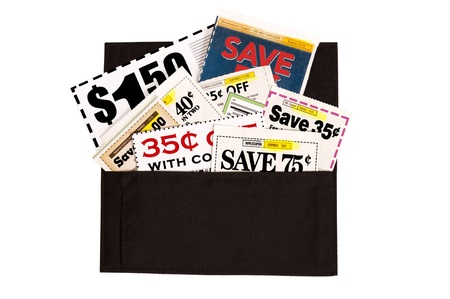 A dark brown cloth wallet full of coupons of various values.