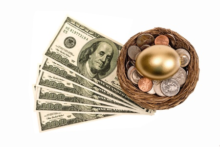 retirement nest egg: Golden Nest Egg With Lots Of Money Isolated On White Stock Photo