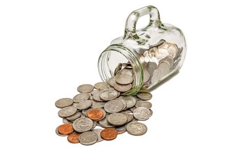 pennies: Glass Mug Spilling Out Coins XXXL Vertical Shot