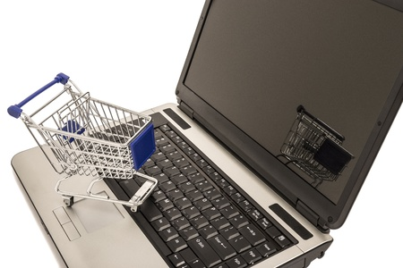 Shopping Cart On Open Laptop  Stock Photo - 18167216