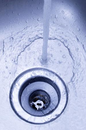 sink drain: Kitchen Sink With Water Running