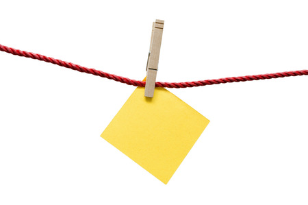 Blank Yellow Textured Paper Hanging On Rope With Clothespin photo