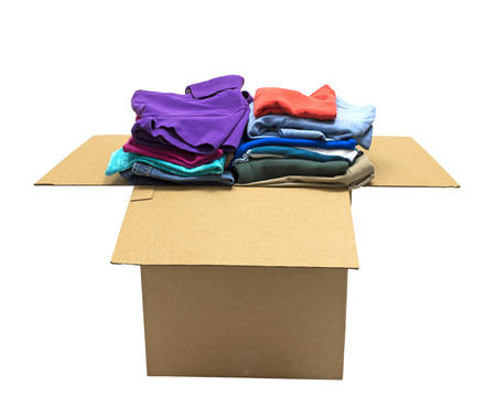 Neatly Folded Clothes In Box Isolated On White Background Focus On Front photo