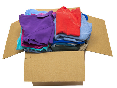 neatly: Box Full Of Neatly Folded Clothes Isolated On A White Background Focus On Front Stock Photo