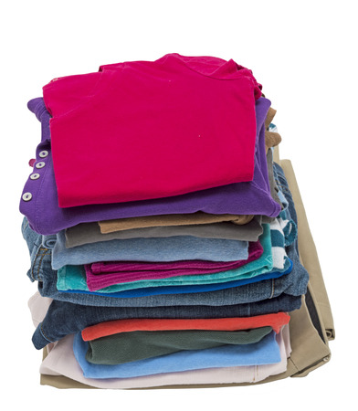 unwanted: Tall Stack Of Folded Clothing Ready To Donate Or Other Concept