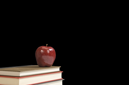 Books and a Shiny Red Apple photo