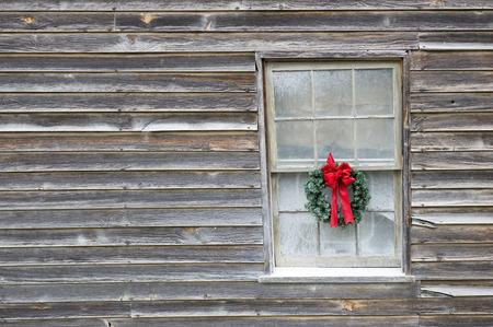 bow window: Christmas Wreath on an Old Farmhouse