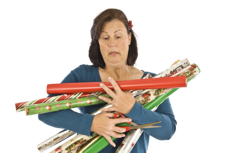 over burdened: Too Many Rolls of Christmas Wrapping Paper to Carry