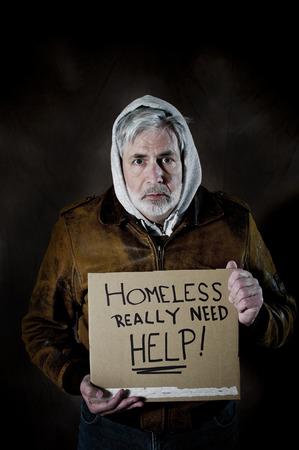 needing: Homeless Man Holding Sign Needing Help Studio Shot Stock Photo