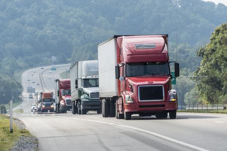 Big Truck Convoy Traveling On Highway