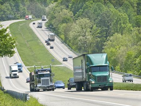 Trucks And Traffic Climbing A Hill