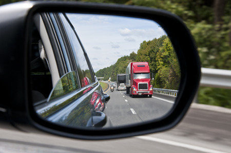 Traffic Shown In Rearview Mirror Stock Photo