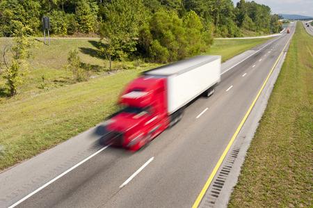 Big Red Truck Speeding Down Highway Stock Photo