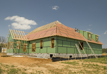 identifiable: Big Roof Going On New Home (Worker Not Identifiable) Stock Photo