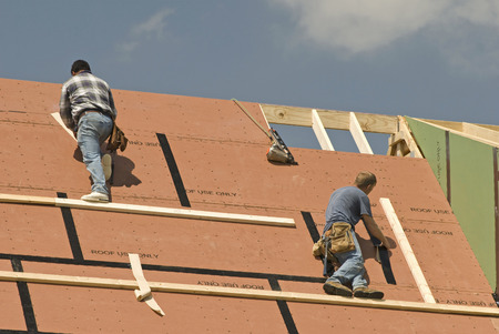 identifiable: Roofers Constructing A New Home( Workers Are Not Identifiable)