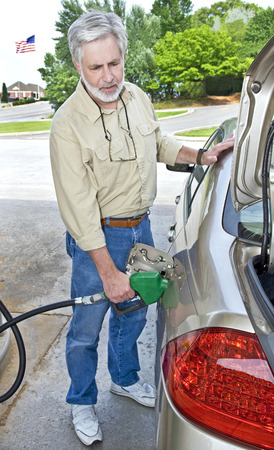 fillup: Another Expensive Fill-Up- Man Pumping Gas