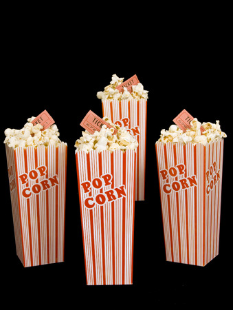 Four Small Buckets Of Fresh Popped Popcorn With Tickets Stock Photo
