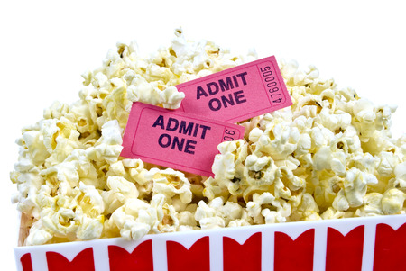 Close Up Shot Of Bucket Full Of Popcorn With Tickets Stock Photo