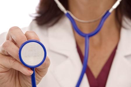 holding close: Doctor Using Stethoscope