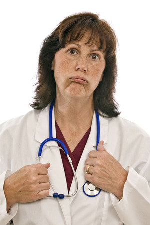 exasperated: Exhausted or Exasperated Doctor Stock Photo