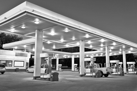 identifying: Black and White Retail Gasoline Station With Convenience StoreAll Identifying Logos Have been removed. Stock Photo