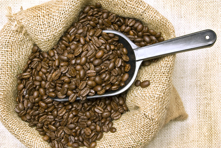 Coffee Beans With Scoop In Burlap Bag Overhead Shot photo