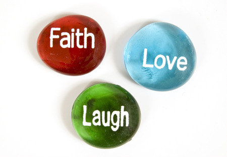 Faith Love and Laugh Encouragement Stones On White Background photo