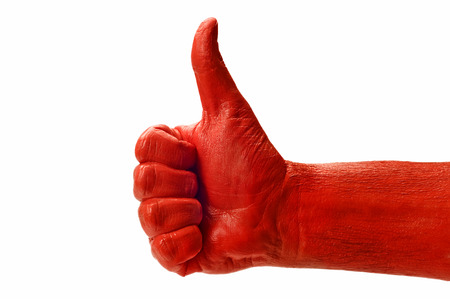 Big Red Hand Giving A Thumbs Up On White Background photo