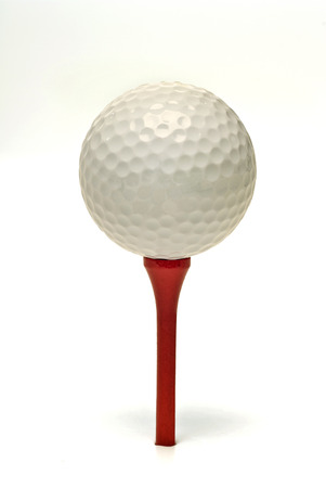 Golf Ball On Red Tee Isolated On White Background Stock Photo