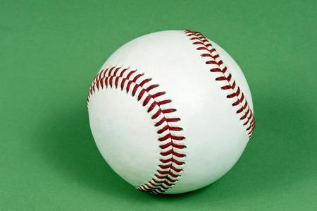 New Baseball On Green Background
