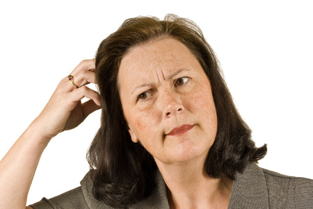 Woman Confused And Scratching Her Head