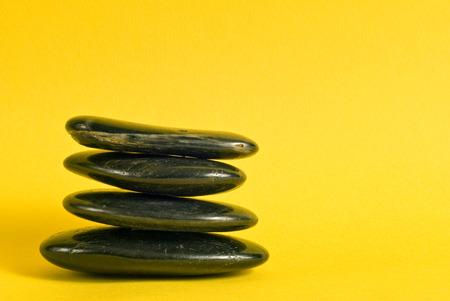 steadiness: Balanced Zen Stones On Yellow Background