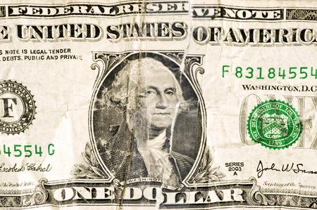 torn: Crumpled And Torn Dollar Bill Close Up Shot