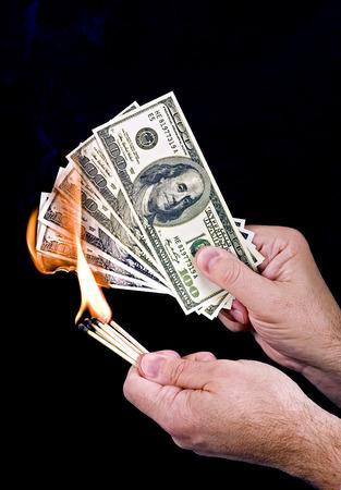 wasteful: Money To Burn Stock Photo