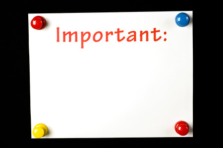 important: Important Note Attached With Colorful Pushpins On Black Background Stock Photo