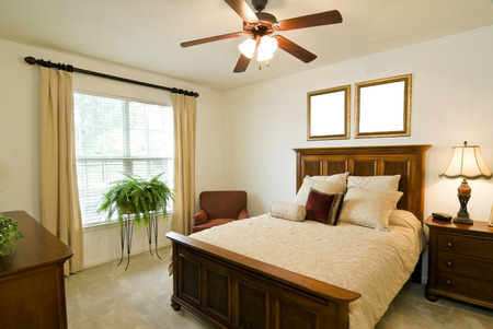 fan ceiling: Bedroom With Blank Frames Above Bed