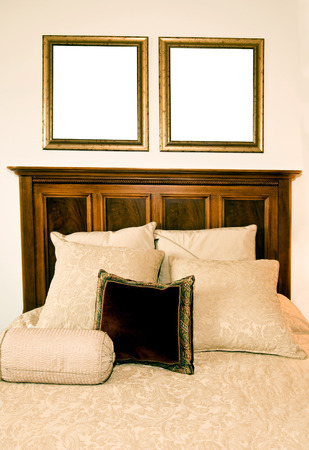 Beautiful Bed With Blank Frames Above photo