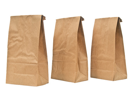 brown: Brown Lunch Bags With Tops Folded On White Background